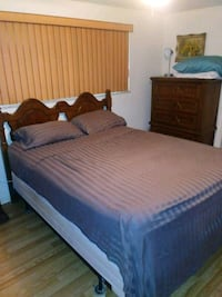 brown wooden bed frame with white bed sheet New Port Richey, 34652