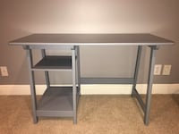 """Gray desk - with shelving on left hand side. Good condition (minor scratches, barely noticeable). 47"""" wide, 29"""" tall, 20"""" depth. 835 mi"""