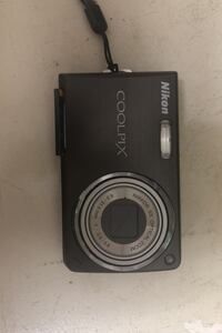 Nikon CoolPix- Negotiable. No charger. Memory card slot stays open. Raymond, 39154