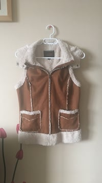 brown and white zip-up vest 2468 km