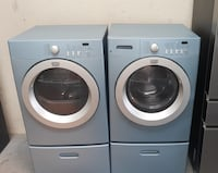 Blue Frigidaire washer and electric dryer on pedestals