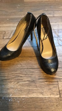 Pair of women's black and gold pumps