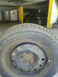 black bullet hole car wheel with tire Montreal