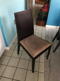 Four Wood and fabric dining chairs
