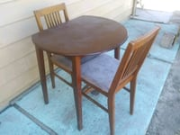 round brown wooden table with two chairs Nampa, 83651