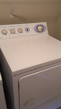 white front-load clothes washer Laval, H7T 3C1