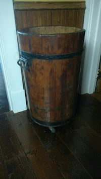 Old wooden sauerkruat crock on wheels