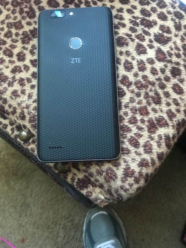 Black lg android smartphone with black case