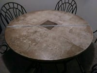 round brown wooden table with chairs Palm Desert, 92211