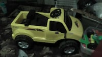 toddler's yellow and black ride on pickup truck