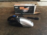 gray and black handheld vacuum cleaner with box null, V9L