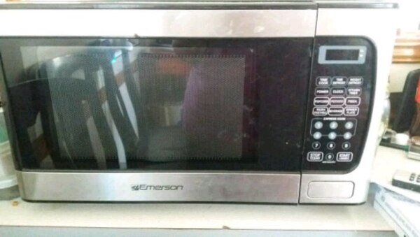 stainless steel and black microwave oven