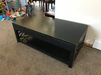 Coffee table that has storage in the middle and the top shifts up. Black and a few imperfections but nothing real noticeable. 48L x 24W x 171/2H Council Bluffs, 51503