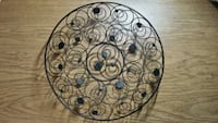 round black steel wall candle holder