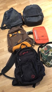 black and red backpack and black backpack 3749 km