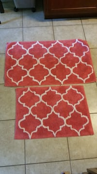 Salmon and white bathroom rugs. Total of five. One large and 4 small. Bought at Kohls. Jacksonville, 32218