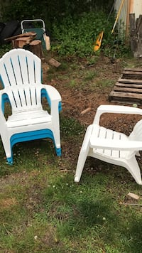 white and blue plastic armchairs