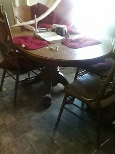 round brown wooden frame table with chairs