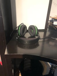 Black and green corded headphones Langley, V3A 7C4