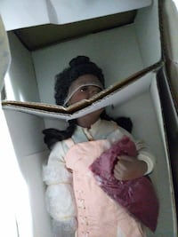 female doll in pink and white dress