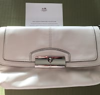 Brand new coach white leather grain purse.