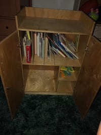Cabinet can be used for books or anything.. it is missing the first front wheels so it's a little uneven  Albuquerque
