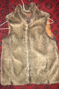 A brown fluffy vest size small for 10/11 year old Surrey, V3W 0C1