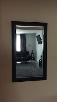 Rectangular black wooden framed wall mirror 41 inches by 25 inches