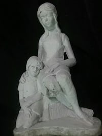 STONE STATUE OF MOTHER HOLDING DAUGHTER