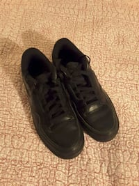 pair of black lace-up low-top shoes