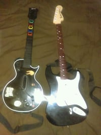 two black and white guitar hero controllers Chicago, 60647