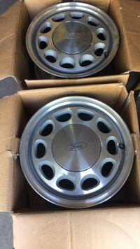 4 rims for a Ford Mustang 80's-90's