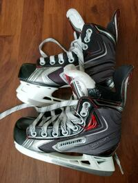 pair of black-and-white Bauer ice skates Surrey, V3R