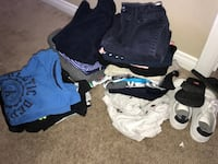 assorted-color of clothes lot and pair of white shoes