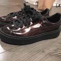 brown-and-black Puma low-top shoes Toronto, M4Y 1G3