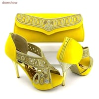pair of yellow leather peep toe platform stilettos Toronto, M6M 5A5
