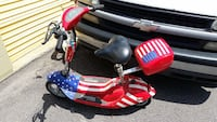 toddler's red and blue electric scooter