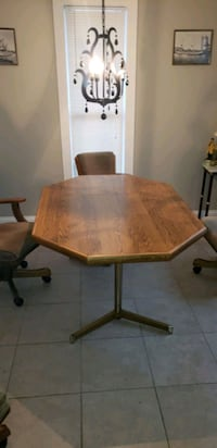 brown wooden table with chairs Abbeville, 70510