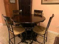 round brown wooden table with four chairs dining set Frederick, 21701