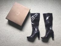 pair of black leather heeled boots Dollard-des-Ormeaux, H9B 2Y8