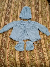 Baby's blue knitted outfit