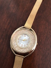 round silver-colored analog watch with brown leather strap Las Vegas, 89169