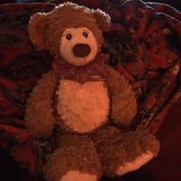 brown and white teddy bear plush toy