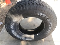 Black automotive tire with black auto rim