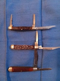 three brown folding knives