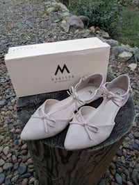 pair of white leather open-toe heels null
