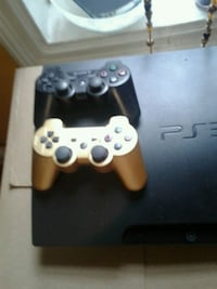 black Sony PS3 slim console with two controllers Bronx, 10468