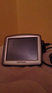 Gray and black tomtom gps navigator.