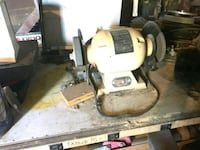 white and black bench grinder