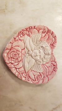 pink and white floral ceramic plate
